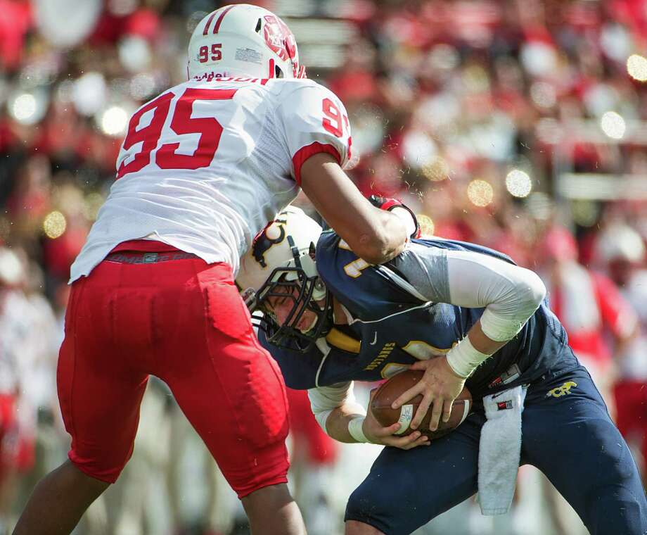 Cy Ranch quarterback Cole Martin (14) is sacked by Katy defensive lineman Tim Wilkerson (95) during the first half of a Class 5A Division II Region III high school football playoff game at Rice Stadium, Saturday, Dec. 8, 2012, in Houston. Photo: Smiley N. Pool, Houston Chronicle / © 2012  Houston Chronicle