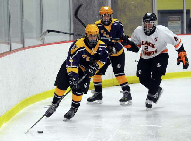 Westhill's Szczepan Misiak controls the puck as Stamford and Westhill High Schools compete in a Boys Ice Hockey Jamboree at Terry Conners Ice Rink in Stamford on Saturday, December 8, 2012. Photo: Lindsay Niegelberg / Stamford Advocate