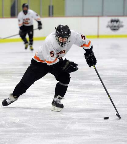 Stamford and Westhill High Schools compete in a Boys Ice Hockey Jamboree at Terry Conners Ice Rink in Stamford on Saturday, December 8, 2012. Photo: Lindsay Niegelberg / Stamford Advocate
