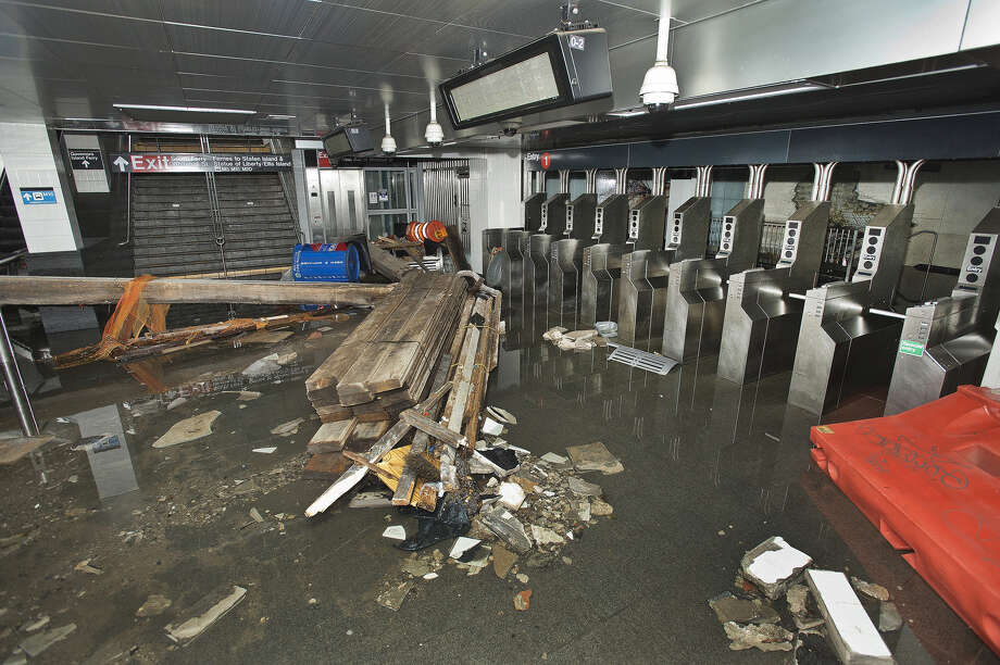 FILE- In this Oct. 30 2012 file photo provided by the Metropolitan Transportation Authority, the South Ferry subway station in New York City is filled with seawater and debris from Superstorm Sandy. More than three decades before Sandy, a state law and a series of legislative reports began warning New York politicians to prepare for a storm of historic proportions, spelling out scenarios eerily similar to what actually happened. (AP Photo/ Metropolitan Transportation Authority, File) Photo: Patrick Cashin