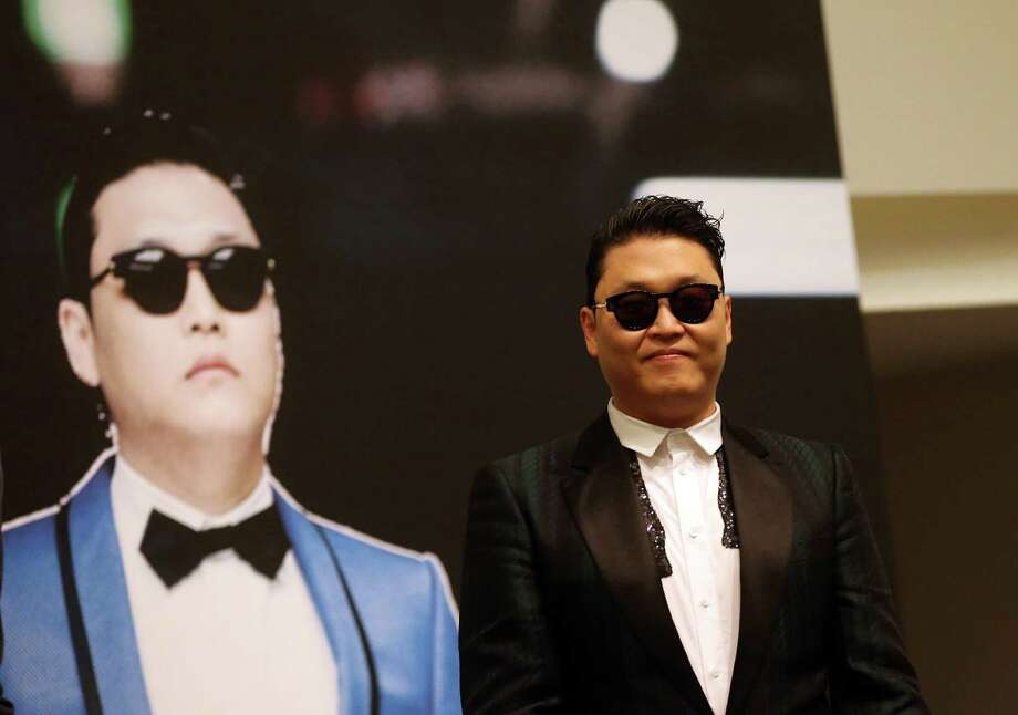 """FILE - In this Dec. 1, 2012 file photo, South Korean rapper PSY, who gained popularity from his famous song """"Gangnam Style,"""" gives a press conference prior to his concert at the Marina Bay Sands in Singapore. President Barack Obama still intends to attend a charity concert where PSY is scheduled to perform after reports the South Korean rapper participated in anti-American protests several years ago. (AP Photo/Wong Maye-E, File) Photo: Wong Maye-E, STF / AP"""