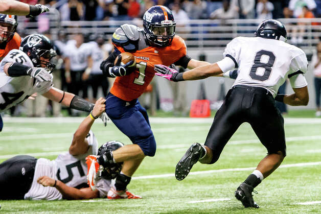 Brandeis's Trinton Ynclan (center) fights towards the goal line as Steele's John Burton (from right), Mason Martinez and Garth Tubbs close in during the third quarter of their Class 5A Division II state quarterfinal game at the Alamodome on Dec. 8, 2012.  Steele won the game 28-12.   MARVIN PFEIFFER/ mpfeiffer@express-news.net Photo: MARVIN PFEIFFER, For The Express-News / Express-News 2012
