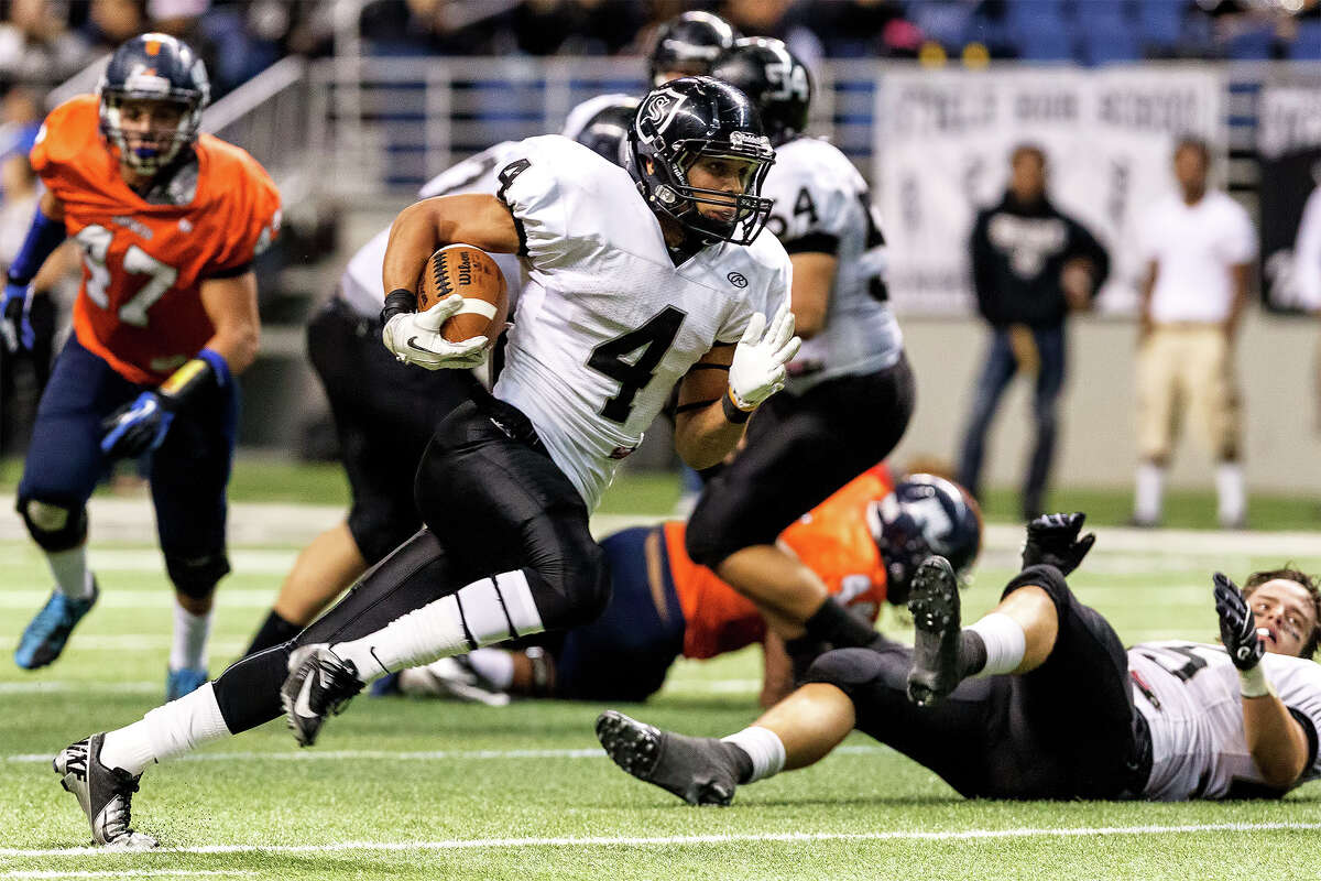 Steele 's Justin Stockton (4) picks up yardage during their Class 5A Division II state quarterfinal game with Brandeis at the Alamodome on Dec. 8, 2012. Stockton rushed for 202 yards on 12 carries and scored two touchdowns to help Steele beat the Broncos 28-12. MARVIN PFEIFFER/ mpfeiffer@express-news.net