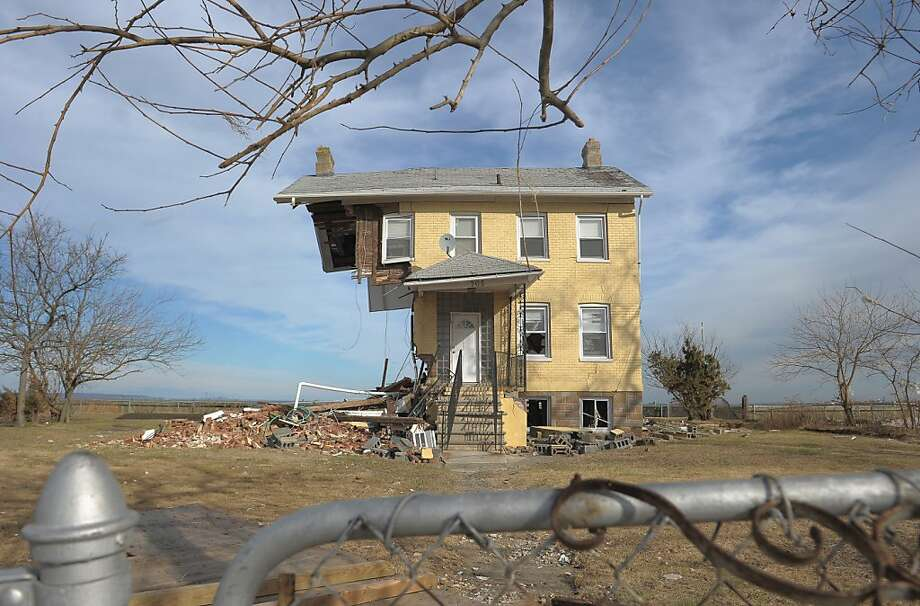 What's left of the Princess Cottage Inn, torn apart by Superstorm Sandy, sits near the shore in Union Beach, N.J. Hard-hit states are urging quick approval of a federal disaster-relief package. Photo: Michael Loccisano, Getty Images