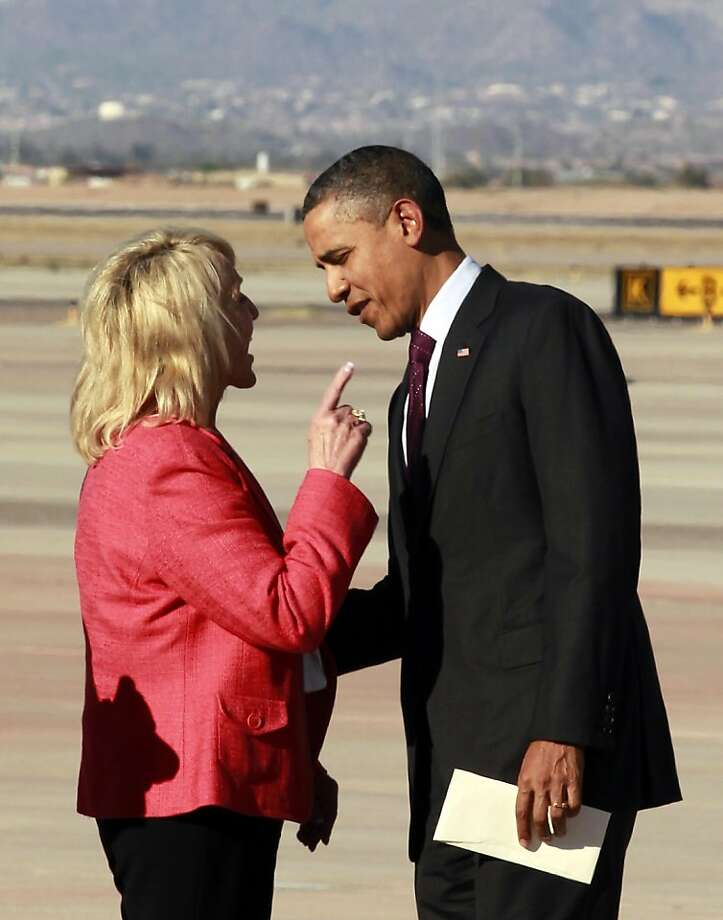 "Arizona Gov. Jan Brewer points during an intense conversation with President Barack Obama after he arrived at Phoenix-Mesa Gateway Airport, Wednesday, Jan. 25, 2012, in Mesa, Ariz. Asked moments later what the conversation was about, Brewer, a Republican, said: ""He was a little disturbed about my book."" Brewer recently published a book, ""Scorpions for Breakfast,"" something of a memoir of her years growing up and defends her signing of Arizona's controversial law cracking down on illegal immigrants, which Obama opposes. Obama was objecting to Brewer's description of a meeting he and Brewer had at the White House, where she described Obama as lecturing her. (AP Photo/Haraz N. Ghanbari) Photo: Haraz N. Ghanbari, Associated Press"