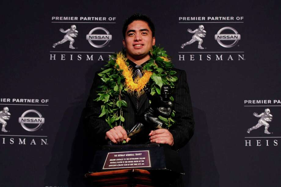 NEW YORK, NY - DECEMBER 08:  Heisman finalists linebacker Manti Te'o of the University of Notre Dame Fighting Irish poses with the Heisman Memorial Trophy Award after a press conference prior to the 78th  Heisman Trophy Presentation at the Marriott Marquis on December 8, 2012 in New York City. Photo: Mike Stobe, Getty Images / 2012 Getty Images