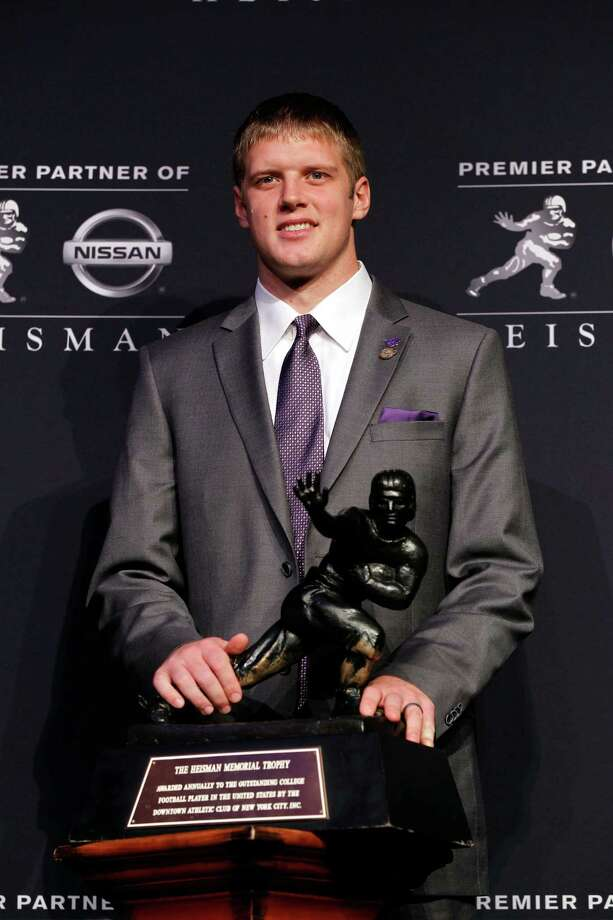 NEW YORK, NY - DECEMBER 08:  Heisman finalists quarterback Collin Klein of the Kansas State Wildcats poses with the Heisman Memorial Trophy Award after a press conference prior to the 78th  Heisman Trophy Presentation at the Marriott Marquis on December 8, 2012 in New York City. Photo: Mike Stobe, Getty Images / 2012 Getty Images