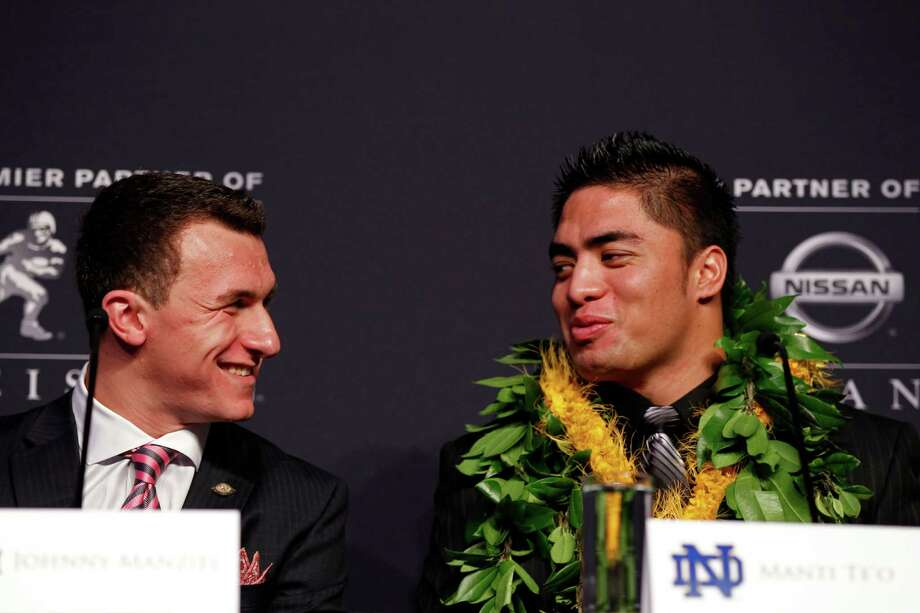 NEW YORK, NY - DECEMBER 08:  (L-R) Heisman finalists quarterback Johnny Manziel of the Texas A&M University Aggies talks to linebacker Manti Te'o of the University of Notre Dame Fighting Irish during a press conference prior to the 78th  Heisman Trophy Presentation at the Marriott Marquis on December 8, 2012 in New York City. Photo: Mike Stobe, Getty Images / 2012 Getty Images