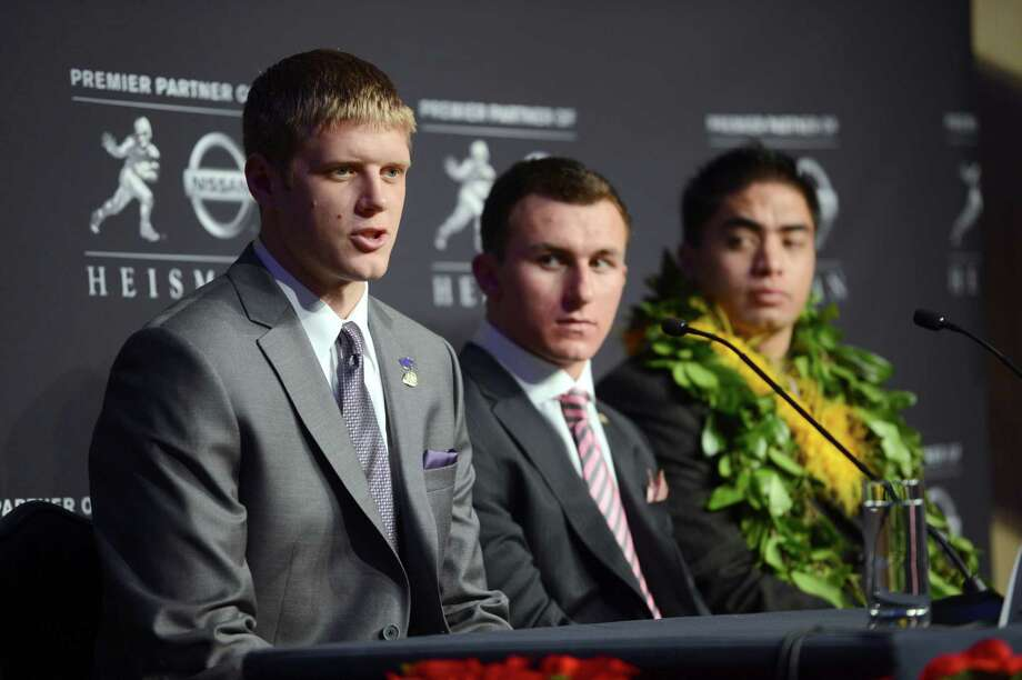 Heisman Trophy finalists Collin Klein, left, of Kansas State; Johnny Manziel, center, of Texas A&M; and Manti Te'o, of Notre Dame, attend a news conference prior to the announcement of the trophy winner, Saturday, Dec. 8, 2012, in New York. (AP Photo/Henny Ray Abrams) Photo: Henny Ray Abrams, Associated Press / FR151332 AP