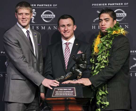Heisman finalists Kansas State's quarterback Collin Klein (from left), Texas A&M's quarterback Johnny Manziel, and Notre Dame's linebacker Manti Te'o pose for photos during a press conference before the Heisman winner announcement Saturday Dec. 8, 2012 at the New York Marriott Marquis hotel in New York, New York. (Edward A. Ornelas / San Antonio Express-News)