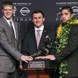 Heisman finalists Kansas State's quarterback Collin Klein (from left), Texas A&M's quarterback Johnny Manziel, and Notre Dame's linebacker Manti Te'o pose for photos during a press conference before the Heisman winner announcement Saturday Dec. 8, 2012 at the New York Marriott Marquis hotel in New York, New York.