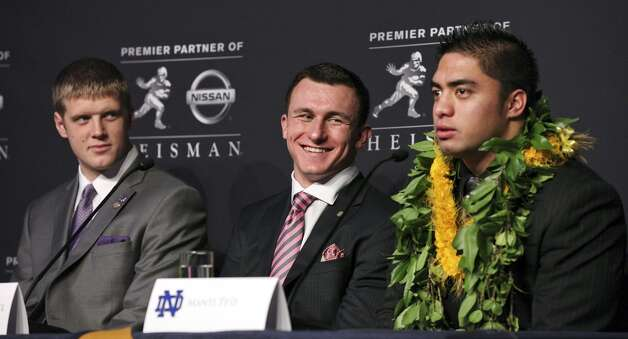 Heisman finalists Kansas State's quarterback Collin Klein (from left), Texas A&M's quarterback Johnny Manziel, and Notre Dame's linebacker Manti Te'o answer questions from the media during a press conference before the Heisman winner announcement Saturday Dec. 8, 2012 at the New York Marriott Marquis hotel in New York, New York. (Edward A. Ornelas / San Antonio Express-News)