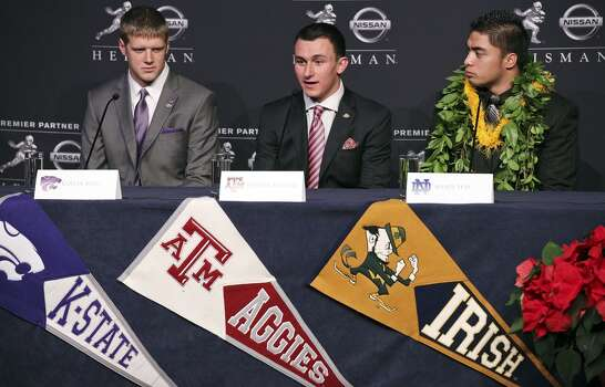 Heisman finalists Kansas State's quarterback Collin Klein (from left), Texas A&M's quarterback Johnny Manziel, and Notre Dame's linebacker Manti Te'o answer questions from the media during a press conference before the Heisman winner announcement Saturday Dec. 8, 2012 at the New York Marriott Marquis hotel in New York, New York.