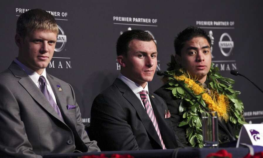 Heisman finalists Kansas State's quarterback Collin Klein (from left), Texas A&M's quarterback Johnn