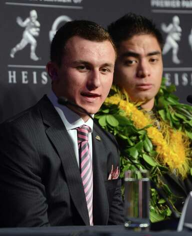 Heisman Trophy finalists Johnny Manziel, left, a quarterback from Texas A&M, left, and Manti Te'o, a linebacker from Notre Dame, speak at a news conference prior to the announcement of the trophy winner, Saturday, Dec. 8, 2012, in New York. (AP Photo/Henny Ray Abrams) Photo: Henny Ray Abrams, FRE / FR151332 AP