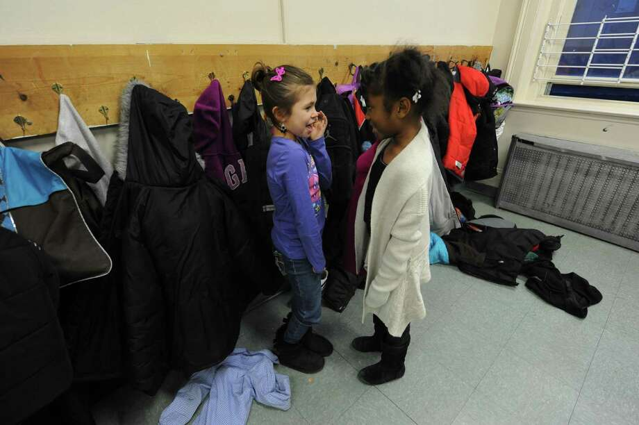 Seven-year-olds Donella Jordan, left, and Briana Morton enjoy a chat during the after school program at Trinity Alliance in Albany, NY Thursday Dec. 6, 2012. (Michael P. Farrell/Times Union) Photo: Michael P. Farrell