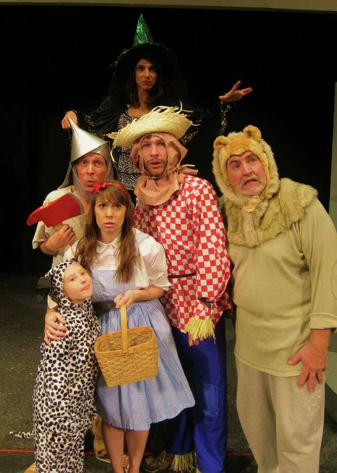 "Toto (Caroline Whitaker), Dorothy (Kathryn Starczewski); middle: Tin Woodman (Alan Edstrom), Scarecrow (Conrad Browne Lorcher), Lion (Pat Leathem); back: Wicked Witch of the West (Gloria Ford) in Home Made Theater's production of ""The Wizard of Oz,"" through Dec. 15, 2012. (Home Made Theater)"