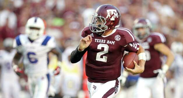 Texas A&M University quarterback Johnny Manziel (2) looks around as he breaks away for a touchdown during the second quarter of a NCAA football game against South Carolina State University, Saturday, Sept. 22, 2012, in College Station.  ( Nick de la Torre / Houston Chronicle ) Photo: Nick De La Torre, Staff / 2012 Houston Chronicle