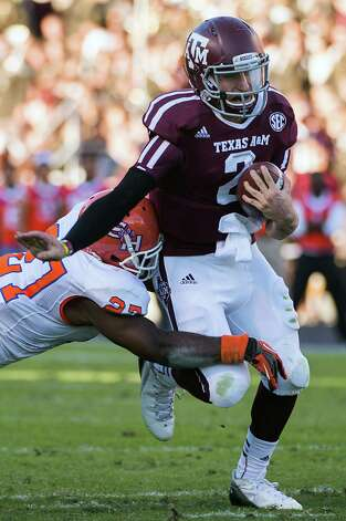 Texas A&M quarterback Johnny Manziel (2) runs for a first down during the first half of a college football game against Sam Houston State at Kyle Field, Saturday, Nov. 17, 2012, in College Station. ( Smiley N. Pool / Houston Chronicle ) Photo: Smiley N. Pool, Staff / © 2012  Houston Chronicle