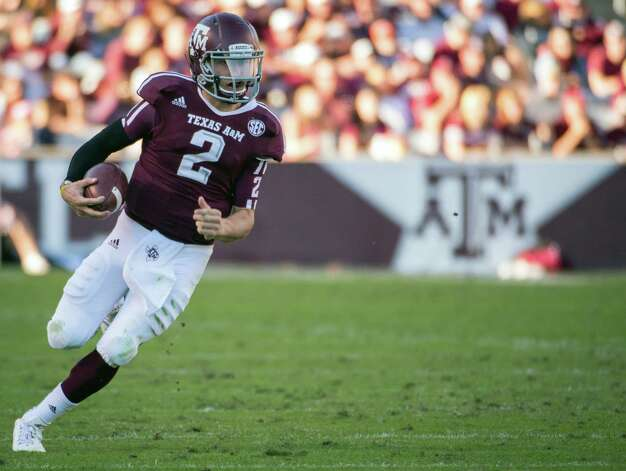 Texas A&M quarterback Johnny Manziel (2) scrambles during the first half of a college football game at Kyle Field, Saturday, Nov. 17, 2012, in College Station. ( Smiley N. Pool / Houston Chronicle ) Photo: Smiley N. Pool, Staff / © 2012  Houston Chronicle