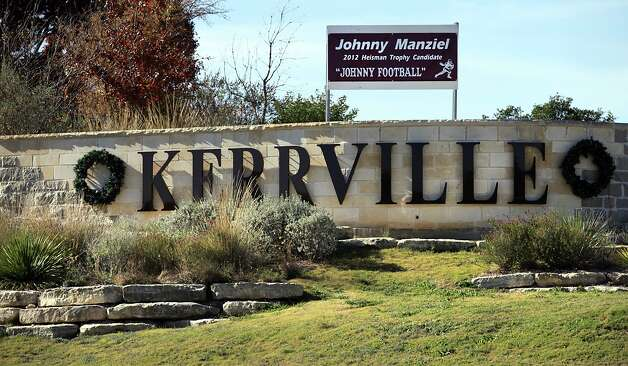 City officials have placed a banner at the entrance to Kerrville, Tx, on I-10, showing their support for hometown hero and Heisman Trophy candidate Johnny Manziel, where he attended Tivy High School.  Wednesday, Dec. 5, 2012. Photo: Bob Owen, STAFF / © 2012 San Antonio Express-News