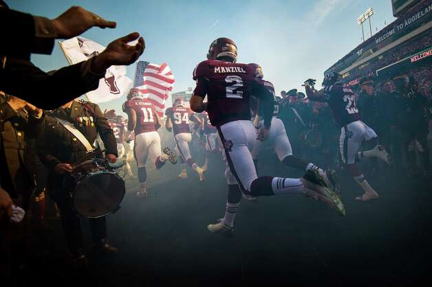 Texas A&M quarterback Johnny Manziel (2) runs  onto the field before facing Sam Houston State in a college football game at Kyle Field, Saturday, Nov. 17, 2012, in College Station. ( Smiley N. Pool / Houston Chronicle ) Photo: Smiley N. Pool, Staff / © 2012  Houston Chronicle