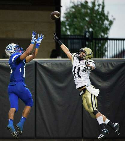 Georgetown wide receiver Randy Knightner (18) catches a touchdown pass over Nederland's Zach Taylor (11) during the second half of a Class 4A Division I Region III high school football playoff game at Berry Center, Saturday, Dec. 8, 2012, in Houston. Photo: Smiley N. Pool, Houston Chronicle / © 2012  Houston Chronicle