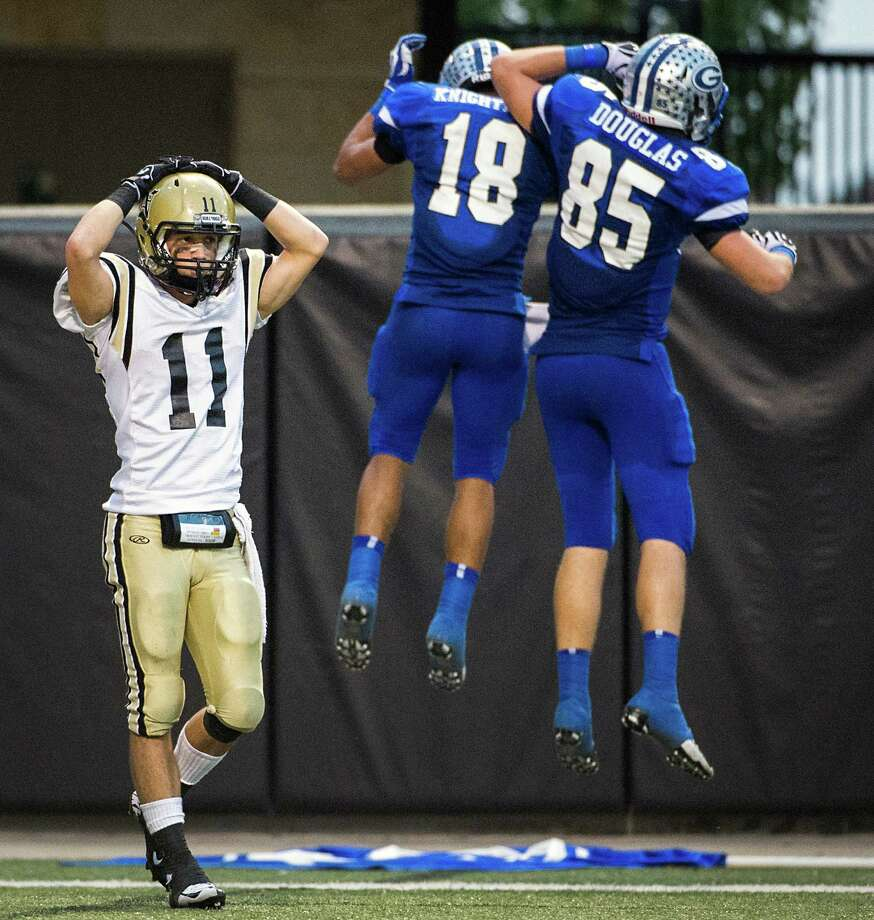 Nederland's Zach Taylor (11) reacts as Georgetown wide receiver Randy Knightner (18) celebrates a touchdown catch with Noah Douglas (85) during the second half of a Class 4A Division I Region III high school football playoff game at Berry Center, Saturday, Dec. 8, 2012, in Houston. Photo: Smiley N. Pool, Houston Chronicle / © 2012  Houston Chronicle