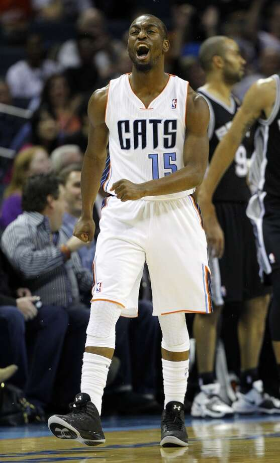 Charlotte Bobcats' Kemba Walker (15) reacts after making a three-point shot against the San Antonio Spurs during the first half of an NBA basketball game in Charlotte, N.C., Saturday, Dec. 8, 2012.  (Chuck Burton / Associated Press)