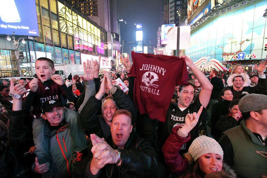 Texas A&M fans celebrate in Times Square as Texas A&M's quarterback Johnny Manziel wins the Heisman Trophy Saturday Dec. 8, 2012 in New York, New York. Photo: Edward A. Ornelas, San Antonio Express-News / © 2012 San Antonio Express-News