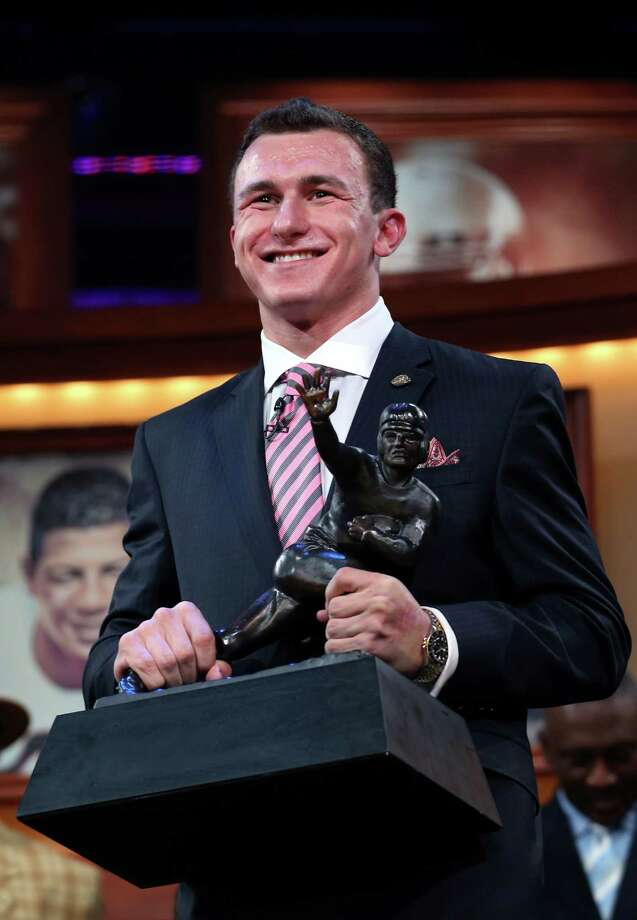 NEW YORK, NY - DECEMBER 08:  Quarterback Johnny Manziel of the Texas A&M University Aggies poses with the Heisman Memorial Trophy after being named the 78th Heisman Memorial Trophy Award winner at the Best Buy Theater on December 8, 2012 in New York City. NOTE TO USER: Photos are for editorial usage only from December 8th to 22nd. No sales, no archive. Photo: Handout, Getty Images For The Heisman Tru / 2012 Kelly Kline
