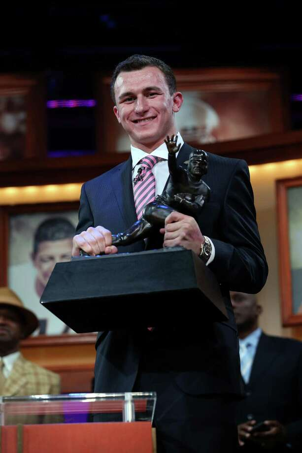 Johnny Football becomes Johnny Heisman After lighting up the SEC in Texas A&M's first season in the conference, quarterback Johnny Manziel became the first freshman to win the Heisman Trophy. Photo: Handout, Getty Images For The Heisman Tru / 2012 Kelly Kline