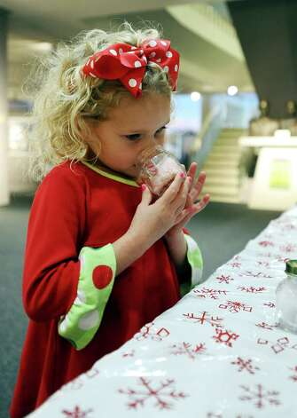 Reese Barlow, 5, of Nederland participates in the Smells of Christmas activity at the Museum of the Gulf Coast for Sleigh Bells Ring! in Port Arthur on Saturday, December, 8 2012. Photo taken: Randy Edwards/The Enterprise Photo: Randy Edwards