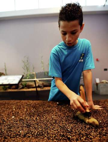 Jonathan Figueroa, 11, shows visitors the ropes to the Candy Cane Dig at the Museum of the Gulf Coast for Sleigh Bells Ring! in Port Arthur on Saturday, December, 8 2012. Photo taken: Randy Edwards/The Enterprise Photo: Randy Edwards