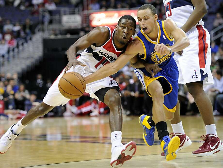 Stephen Curry goes for the steal against Jordan Crawford on a night when the Warriors won despite not playing their best. Photo: Nick Wass, Associated Press