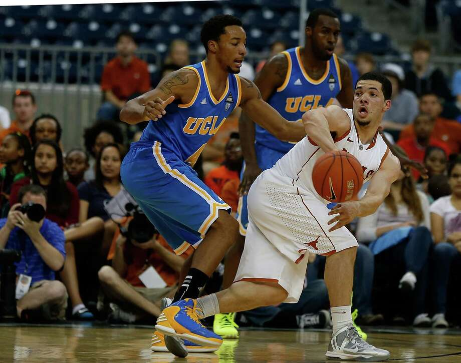 HOUSTON, TX - DECEMBER 08:  Norman Powell #4 of the UCLA Bruins defends Javan Felix #3 of the Texas Longhorns during the MD Anderson Proton Therapy Showcase at Reliant Stadium on December 8, 2012 in Houston, Texas. Photo: Scott Halleran, Getty Images / 2012 Getty Images