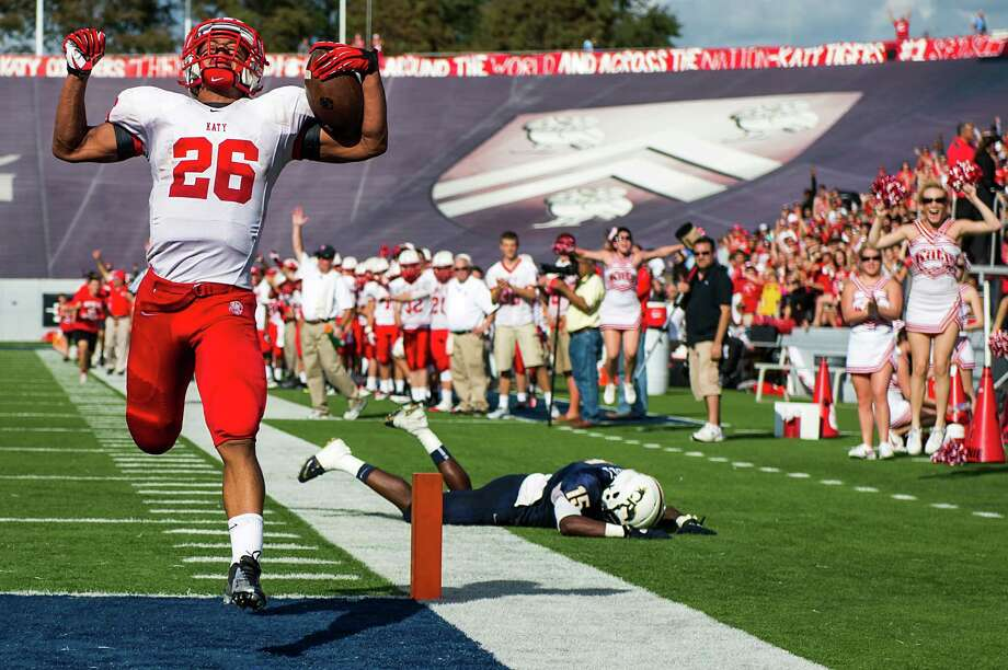 Katy's Rodney Anderson rejoices as he crosses the goal line to complete a 77-yard run in the second quarter Saturday. The Tigers rushed for 483 yards in the game. Photo: Smiley N. Pool, Staff / © 2012  Houston Chronicle