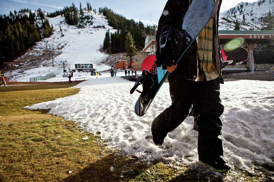 Only patches of snow cover the lawn Friday at the The Village at Squaw Valley in Squaw Valley, Calif. Over all, winter snowfall in the past few years has not declined much in California's Sierra Nevada. Photo: Max Whittaker/Prime, Freelance / ONLINE_YES