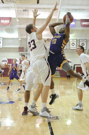 Mike Black of UAlbany puts up a shot against Colgate on Saturday, Dec. 8, 2012 in Hamilton. (Bob Mayberger Photography)