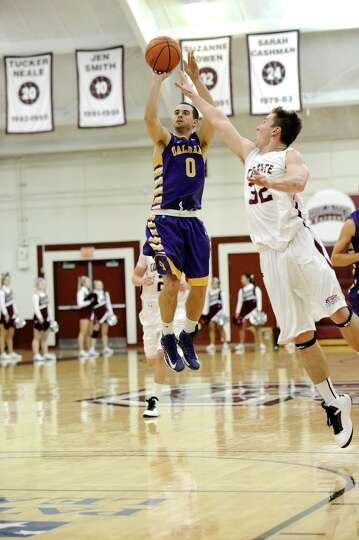 Jacob Iati pulls up and makes one of his six 3-pointers for UAlbany against Colgate on Saturday, Dec