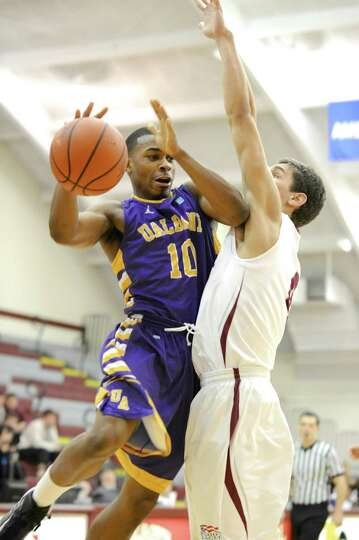 Mike Black of UAlbany is shut off on his way to the basket against Colgate in their game on Saturday