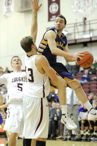 Peter Hooley of UAlbany drives to the basket against Colgate during their game on Saturday, Dec. 8, 2012 in Hamilton. (Bob Mayberger Photography)