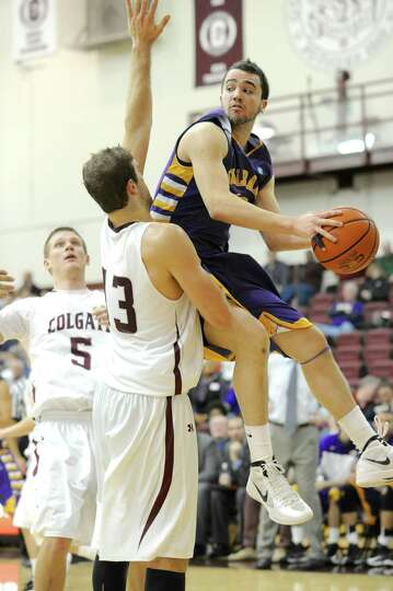 Peter Hooley of UAlbany drives to the basket against Colgate during their game on Saturday, Dec. 8,