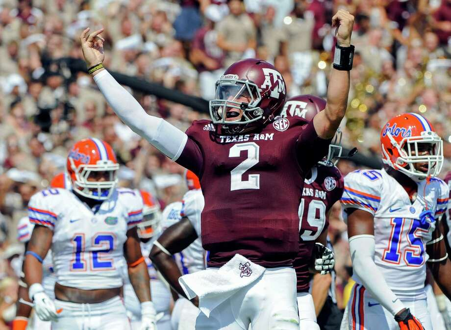 FILE - In this Sept. 8, 2012, file photo, Texas A&M's Johnny Manziel reacts after a touchdown run during the second quarter of an NCAA college football game against Florida in College Station, Texas.  Manziel could become the first freshman to win the Heisman Trophy when the award is presented on Saturday night. (AP Photo/Dave Einsel, File) Photo: Dave Einsel / FR43584 AP