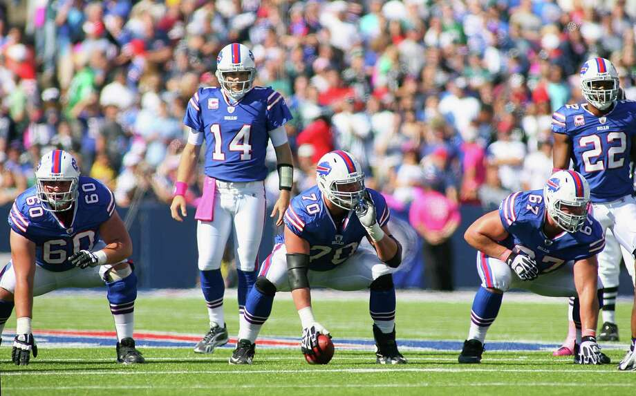 ORCHARD PARK, NY - OCTOBER 09:Ryan Fitzpatrick #14 of the Buffalo Bills linens up behind Kraig Urbik #60,Eric Wood #70 and Andy Levitre #67  against the Philadelphia Eagles  at Ralph Wilson Stadium on October 9, 2011 in Orchard Park, New York. Buffalo woin 31-24.  (Photo by Rick Stewart/Getty Images) Photo: Rick Stewart / 2011 Getty Images