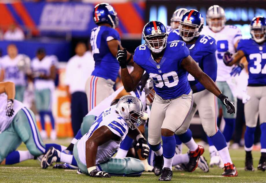 EAST RUTHERFORD, NJ - SEPTEMBER 05:  defensive end Jason Pierre-Paul #90 of the New York Giants reacts after a tackle against the Dallas Cowboys during the 2012 NFL season opener at MetLife Stadium on September 5, 2012 in East Rutherford, New Jersey.  (Photo by Al Bello/Getty Images) Photo: Al Bello / 2012 Getty Images
