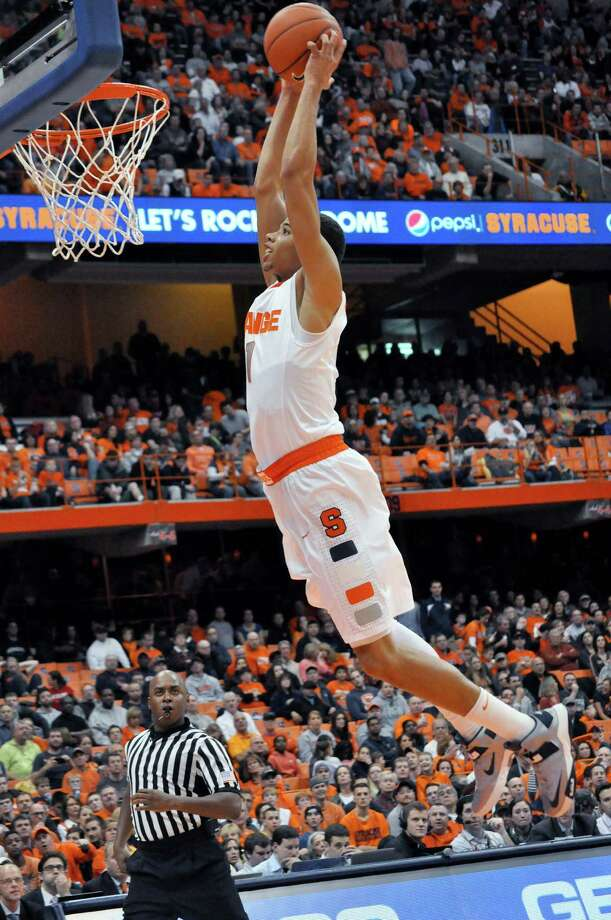 Syracuse's Michael Carter-Williams dunks against Monmouth during the second half of an NCAA college basketball game in Syracuse, N.Y., Saturday, Dec. 8, 2012. Syracuse won 108-56. (AP Photo/Kevin Rivoli) Photo: Kevin Rivoli