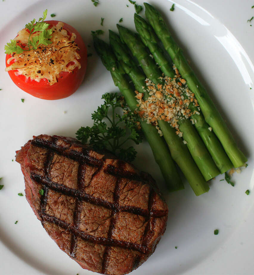 Little Rhein Steak House, 231 S. Alamo St., 210-225-2111, is offering a dinner, $49 plus tax and service charge. Meal includes holiday bread basket; cranberry cornbread; lobster bisque; field greens; choice of prime rib, asparagus and au gratin potatoes or Bay of Fundy salmon fillet lemon with roasted fall vegetables; choice of sticky toffee pudding or apple pie. Photo: Jennifer Whitney, For The Express-News / jwhitney@express-news.net