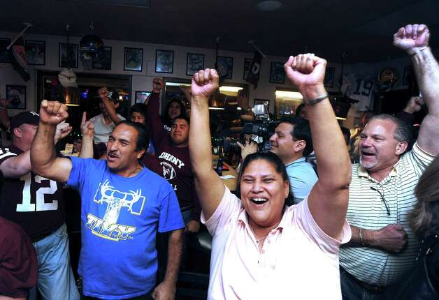 Fans of Texas A&M quarterback Johnny Manziel gather at the Wing King restaurant in Kerrville, Texas, for the televised Heisman Trophy announcement on Saturday night, Dec. 8, 2012. Manziel played high school football for Tivy High School in Kerrville. Photo: Billy Calzada, Express-News / SAN ANTONIO EXPRESS-NEWS