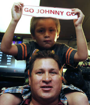 Tony Castillo and son, Jaden, show their enthusiasm for Johnny Manziel, Texas A&M quarterback who won the Heisman trophy, on Saturday, Dec. 8, 2012. Fans in Kerrville, where Manziel played high school football, gathered at the Wing King restaurant. Photo: Billy Calzada, Express-News / SAN ANTONIO EXPRESS-NEWS
